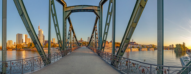 eiserner Steg, famous iron footbridge crosses river Main in Frankfurt with skyline in morning light