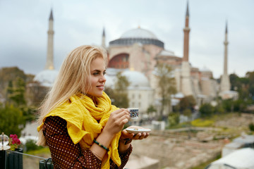 Woman Drinking Turkish Coffee With Mosque On Background