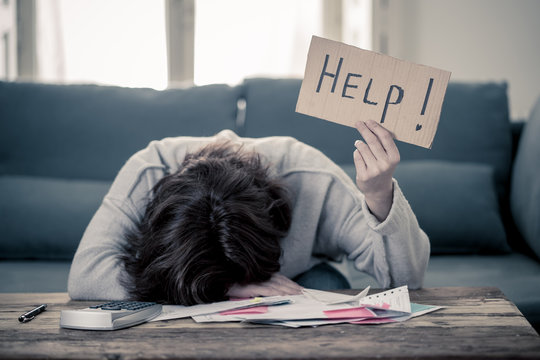 Upset young woman asking for help in paying bills Mortgage home or business finance problems