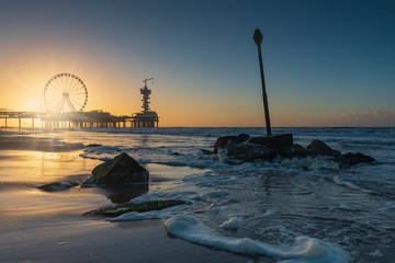 ferris wheel on the Pier at Scheveningen at sunset