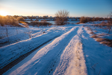 Wall Mural - Winter sunny morning landscape with a country road