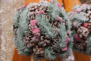 colored christmas ball made from cones of cones and bows