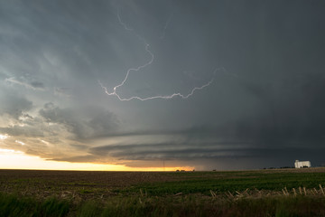 Supercell (rotating) thunderstorm with lightningbolt over Colorado