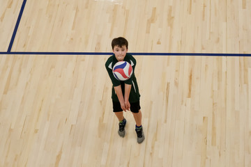 Volleyball player bump sets a ball