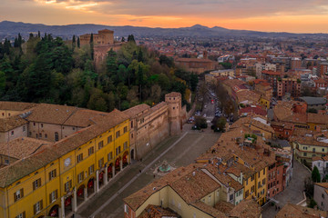 Sunset aerial panorama of Cesena in Emilia Romagna Italy near Forli and Rimini, with the medieval Malatestiana castle, Piazza del Popolo and Roman Catholic churches and cathedral on a winter afternoon