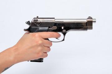 Woman holding gun in hand