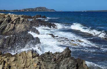 Waves crashing on the rocky shore at Punta Negra, Sardinia