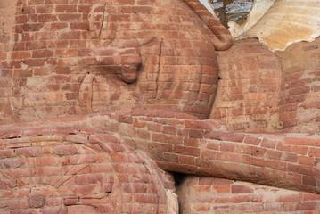Close-up view of the sleeping buddha's face in Polonnaruwa, Sri Lanka.