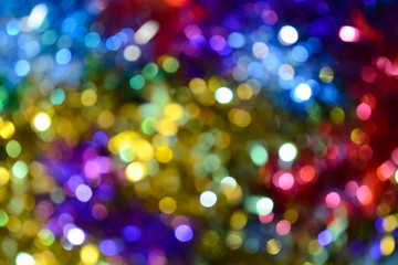 Bokeh. Holiday background. Christmas lights. Glitter. Defocused sparkles. New Year backdrop. Festive wallpaper. Blinks. Carnival. Tinsel. Bokeh retro style photo.