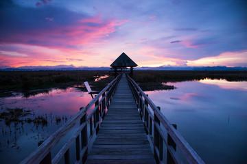 Wooden bridge on sunset sky background, Sam Roi Yot National Park, Thailand