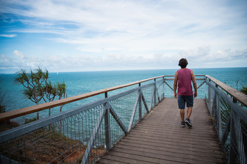 Man Walking on Scenic Pier