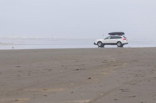 A white family car in Pacific beach area, Ocean Shores, WA