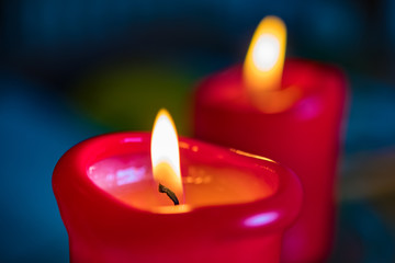 Two red burning candels