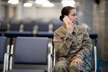 Soldier talking on her cell phone