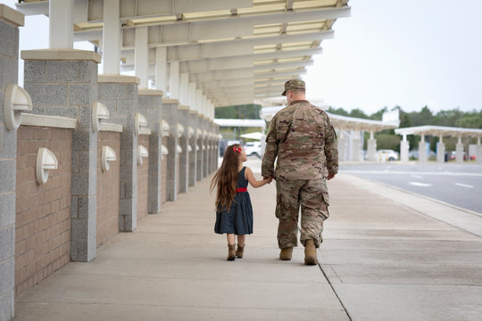 Soldier walking with his daughter