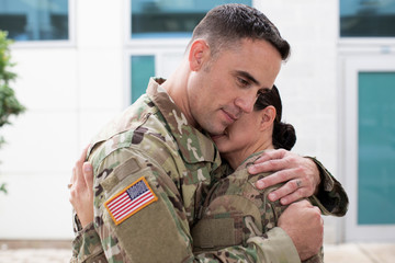 Two soldiers hugging each other