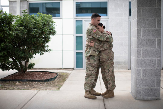 Two soldiers hugging