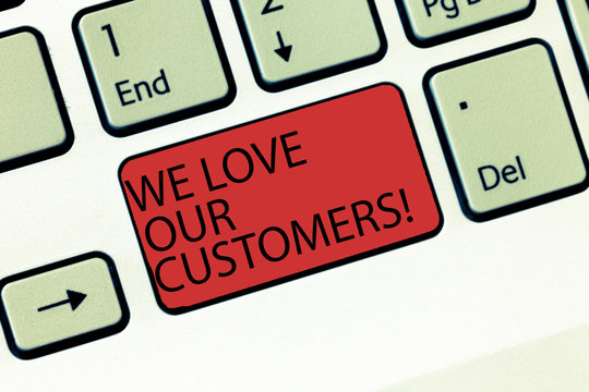 Writing note showing We Love Our Customers. Business photo showcasing Appreciation for clients good customer service Keyboard Intention to create computer message keypad idea