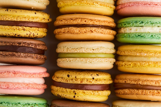Close up of macarons in rows in various colors