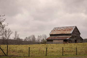 Old barn in field