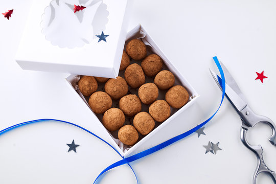 Chocolate truffles coated in cocoa powder in gift box