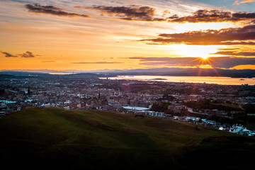 Sunset over Edinburgh city, panoramic view and evening mood, parks and hills, illuminated sky, Scotland Great Britain