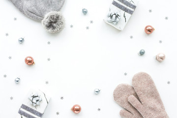 Christmas composition. Marble gift box, decorations, balls, knitted cap, mittens on white background, flat lay, top view