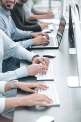background image of a business team using computers