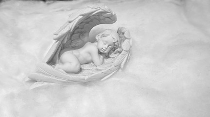 Sleeping little angel on a cloud