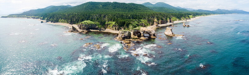 Aerial drone photo of cape Ptichiy (near by cape Velikan), Sakhalin island, Russia (Sahalin). Surrealistic landscape of natural arches created by wind and sea erosion.
