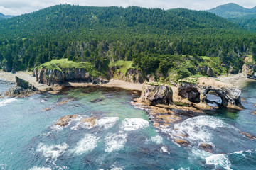 Wide panoramic aerial drone photo of cape Ptichiy (near by cape Velikan), Sakhalin island, Russia (Sahalin). Surrealistic landscape of natural arches created by wind and sea erosion.