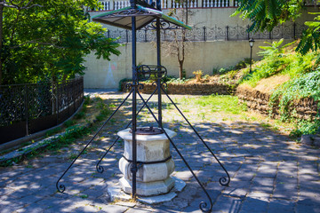 19th century well with a stone bowl and metal frame as a decorative symbol of the city