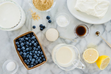Blueberries, sugar, baking powder, lemon peel and maple syrup
