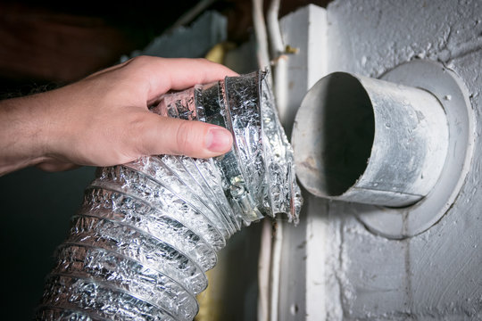 Flexible aluminum dryer vent hose, removed for cleaning/repair/maintenance.