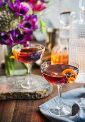 Cosmopolitan Cocktail with orange garnish
