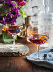 Cosmopolitan Cocktail with orange garnish in a spring table setting