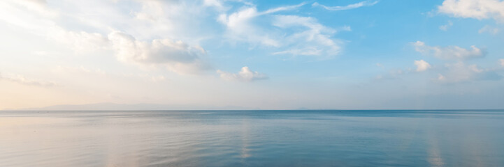 Bright beautiful seascape, sandy beach, clouds reflected in the water, natural minimalistic...