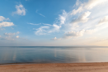Fototapete - Bright beautiful seascape, sandy beach, clouds reflected in the water, natural minimalistic background and texture