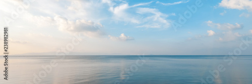 Fototapete Bright beautiful seascape, sandy beach, clouds reflected in the water, natural minimalistic background and texture, panoramic view banner