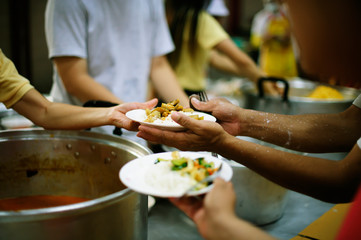 Hand-feeding to the needy in society : concept of food sharing