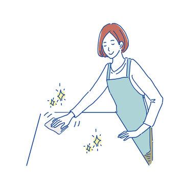 机をふく女性 イラスト