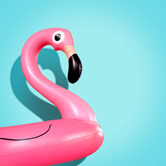 Tuinposter Flamingo Giant inflatable Flamingo on a blue background, pool float party, trendy summer concept
