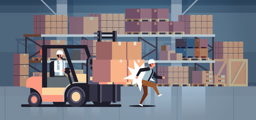 forklift driver hitting colleague factory accident concept warehouse logistic transport driver dangerous injured worker storehouse room interior horizontal