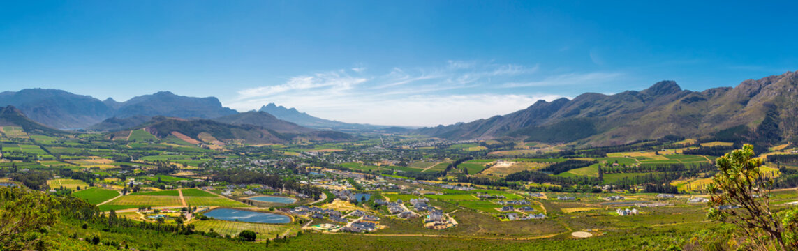 Franschhoek valley panorama with its famous wineries and surrounding mountains, South Africa