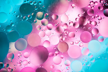 water drops on glass with colorful background, close-up