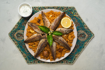 Fish Kabsa - mixed rice dishes that originates in Yemen. Middle eastern food.