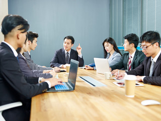 asian corporate business people meeting in office