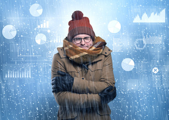 Young businessman shivering with graphs, reports and chart concept