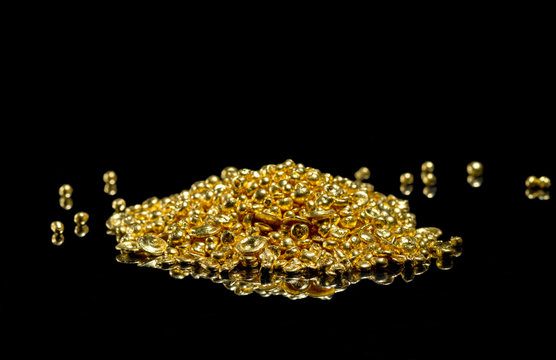 A bunch of gold grains. Isolated on a black background.