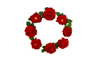 Beautiful wreath of flowers red roses on a white background with space for text. Top view, flat lay